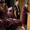 Record-Eagle/Keith King<br /> Briana Torrey delivers a speech near Lance Morgan Jr., second from right, principal, Friday, June 8, 2012 during the Traverse City High School graduation in Lars Hockstad Auditorium at Central Grade School.