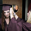 Record-Eagle/Keith King<br /> Hannah Kaley, right, helps Kyra Kurz, both of Traverse City, keep her cap in place Friday, June 8, 2012 prior to the start of the Traverse City High School graduation in Lars Hockstad Auditorium at Central Grade School.