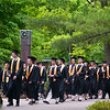 Record-Eagle/Jan-Michael Stump<br /> Traverse City Central High School seniors walk across the campus of the Interlochen Center for the Arts for their graduation Saturday.