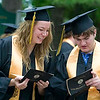 Record-Eagle/Jan-Michael Stump<br /> Traverse City Central High School seniors Kristen Vermetten (cq), left, and Josh Vezina (cq) look through their programs for Saturday graduation at the Interlochen Center for the Arts.