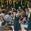 Record-Eagle/Jan-Michael Stump<br /> Traverse City Central High School senior Rachel Cook (cq) waves to family members as she processes into Kresge Auditorium of the Interlochen Center for the Arts with classmates for their graduation Saturday.