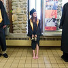 Record-Eagle/Jan-Michael Stump<br /> Traverse City Central High School senior Julie Ash takes a break from her shoes after a long walk from a parking lot at the Interlochen Center for the Arts for her graduation Saturday.