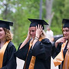 Record-Eagle/Jan-Michael Stump<br /> Traverse City Central High School seniors, from left, Sarah Herpst (cq), Brittany Hess (cq) and Sarah Heuss (cq) hold their caps and gowns in a wind that blew across the campus of the Interlochen Center for the Arts during their graduation Saturday.