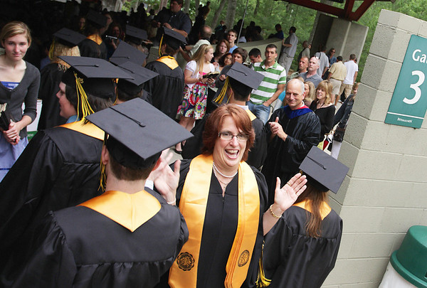 Record-Eagle/ Keith King<br /> Pat Bowen, Traverse City Central High School administrative assistant and senior-class advisor, gives high fives to seniors Saturday, June 12, 2010 as they proceed into Kresge Auditorium for the beginning of their graduation ceremony.