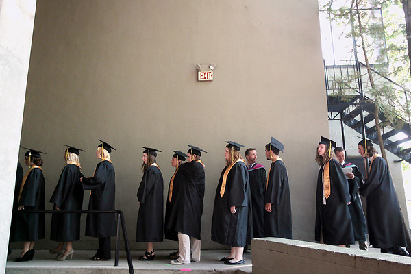 Record-Eagle/Keith King<br /> Graduating seniors wait in line prior to walking across the stage at Kresge Auditorium Sunday, June 3, 2012 during the Traverse City Central High School commencement at the Interlochen Center for the Arts.