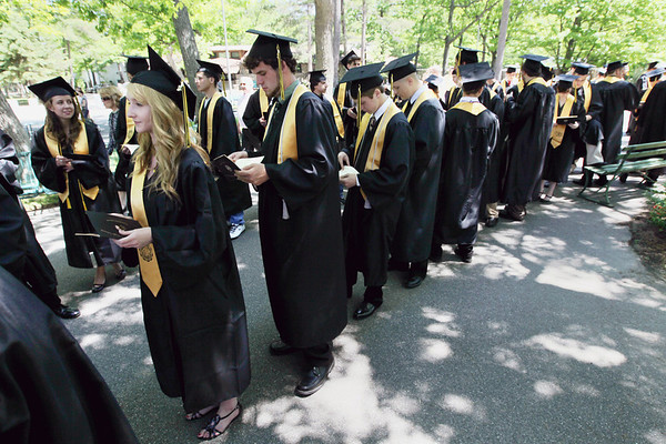 Record-Eagle/Keith King<br /> Leyla Aki, from bottom left, Nick Alpers, Anthony Amalfitano and Kelby Ankerson stand in line Sunday, June 5, 2011 prior to the start of their graduation ceremony at the Interlochen Center for the Arts.