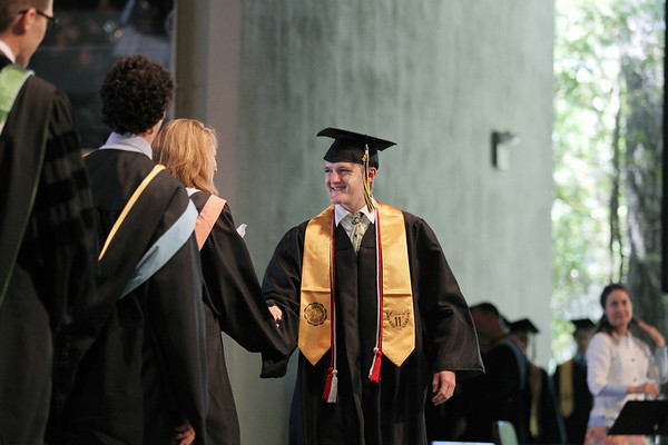 Record-Eagle/Keith King<br /> Ryan Adams is congratulated Sunday, June 5, 2011 during the Traverse City Central High School graduation ceremony in Kresge Auditorium at the Interlochen Center for the Arts.