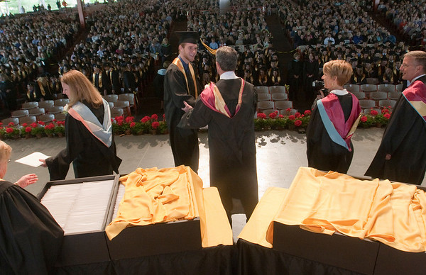 Record-Eagle/Douglas Tesner<br /> TCAPS board members passed out diplomas and congratulated students.