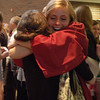 Record-Eagle/Sarah Brower<br /> Kelley Ritsema hugs a friend following graduation.