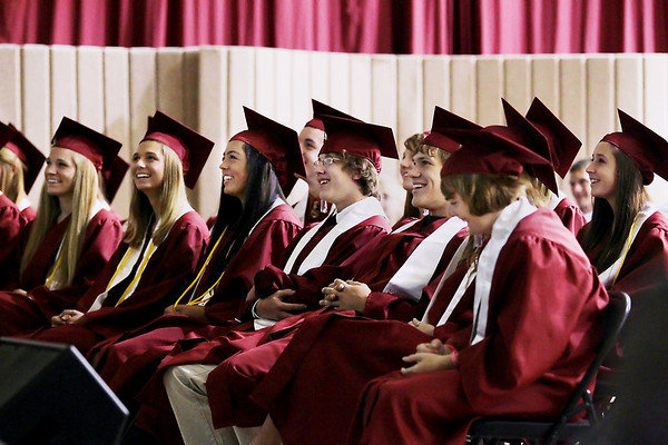 Record-Eagle/Keith King<br /> Traverse City Christian School graduating seniors laugh as a video about the seniors is shown Saturday, June 11, 2011 during the Traverse City Christian School graduation ceremony.
