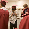 Record-Eagle/Douglas Tesner<br /> <br /> Yusake Vrabe straightens his tie as he and other students get ready for their graduation of Traverse City Christian High School.  Eighteen students graduated at New Hope Community Church in Williamsburg Saturday.