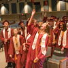 Record-Eagle/Douglas Tesner<br /> <br /> It was all celebration for Anne Friedlander and other graduates after a commencement ceremony for Traverse City Christian High School.  Eighteen students graduated Saturday at New Hope Community Church in Williamsburg.