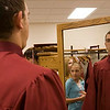 Record-Eagle/Douglas Tesner<br /> <br /> Max Alekseyenko takes a deep breath and checks himself out in a mirror Saturday as he and 17 other students prepare to graduate from Traverse City Christian High School at New Hope Community Church in Williamsburg.
