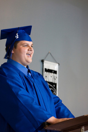 Record-Eagle/ Keith King<br /> Frank O'Brien, 18, of Kalkaska, laughs as he delivers the opening address Wednesday, June 9, 2010 during the Traverse City College Preparatory Academy graduation ceremony.