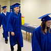 Record-Eagle/ Keith King<br /> Graduating seniors walk through the hallways and toward their seats Wednesday, June 9, 2010 before the start of the Traverse City College Preparatory Academy graduation ceremony.