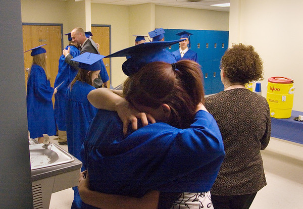"Record-Eagle/ Keith King<br /> Brandi Stewart, right, 16, of Traverse City, hugs Ashley Montgomery, 18, of Traverse City, Wednesday, June 9, 2010 at the conclusion of the Traverse City College Preparatory Academy graduation ceremony. ""She's like a sister to me,"" Brandi said."