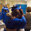 """Record-Eagle/ Keith King<br /> Brandi Stewart, right, 16, of Traverse City, hugs Ashley Montgomery, 18, of Traverse City, Wednesday, June 9, 2010 at the conclusion of the Traverse City College Preparatory Academy graduation ceremony. """"She's like a sister to me,"""" Brandi said."""