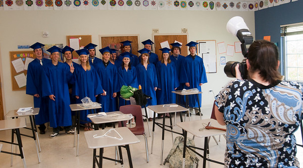 Record-Eagle/Douglas Tesner<br /> Students have their picture taken by Desiree Bozzo just before their commencement ceremony.