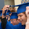 Record-Eagle/Douglas Tesner<br /> Benaiah VanDyken and other students turn their tassels.