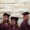 """Record-Eagle/Tyler Sipe<br /> From left to right, Traverse City High graduating seniors Maria Snyder, 19, Libby Ockert, 18, and Chris """"Buffalo"""" Parsons, 18, await the start of Thursday evening's commencement at Milliken Auditorium. Nearly 50 students graduated from the high school"""