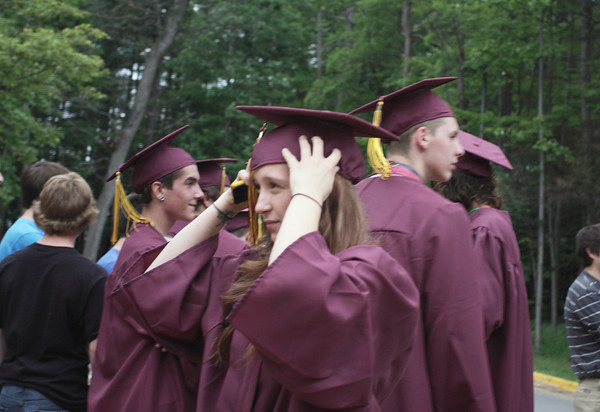 Record-Eagle/ Keith King<br /> Brianna Campeau puts her cap on outside of the Dennos Museum Center Friday, June 11, 2010 prior to the start of Traverse City High School graduation ceremony in Milliken Auditorium.
