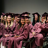 Record-Eagle/Keith King<br /> Traverse City High School graduating seniors laugh as they sit on stage Friday, June 10, 2011 during the Traverse City High School graduation ceremony in Milliken Auditorium at the Dennos Museum Center.