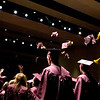Record-Eagle/Jan-Michael Stump<br /> Traverse City High School graduates toss their mortar boards in the air at the end of  Friday's graduation at Milliken Auditorium