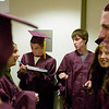 Record-Eagle/Jan-Michael Stump<br /> Traverse City High School seniors, from left, Ben Fish, Shawn Barry, Brooklyn Waterman and Ted Tavis wait outside Milliken Auditorium for the start of Friday's graduation.