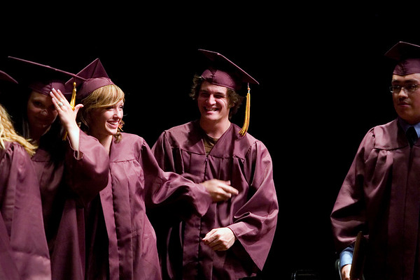 Record-Eagle/Jan-Michael Stump<br /> Traverse City High School seniors Melissa Hills and Jackson Swan laugh while waiting to receive their diplomas during Friday's at Milliken Auditorium