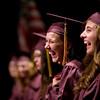 Record-Eagle/Jan-Michael Stump<br /> Traverse City High School seniors Andrea Dixson, left, and Brooklyn Waterman laugh during Friday's graduation at Milliken Auditorium.