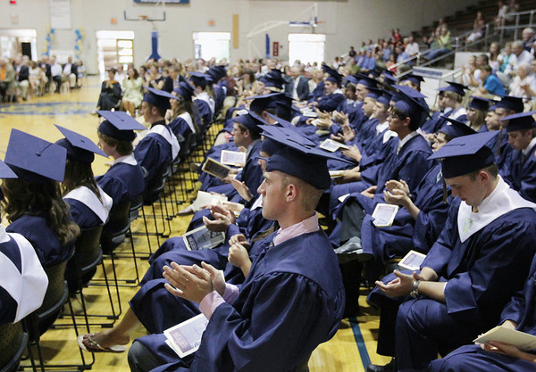 Record-Eagle/Keith King<br /> Zachary Doty applauds along with his fellow graduating 'Class of 2011' Sunday, June 5, 2011 during the Traverse City St. Francis High School graduation ceremony.