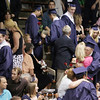 Record-Eagle/Keith King<br /> Graduating seniors hand roses to loved ones Sunday, June 5, 2011 during the Traverse City St. Francis High School graduation ceremony.