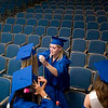 Record-Eagle/Jan-Michael Stump<br /> Traverse City St. Francis High School senior Kaylnn Britten (cq) helps Alexza Meyer (cq) with her cap while waiting for Sunday's graduation.