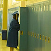 Record-Eagle/Jan-Michael Stump<br /> Traverse City St. Francis High School senior Amanda Haredy (cq) makes a trip to her locker before the start of Sunday's graduation.