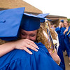 Record-Eagle/Jan-Michael Stump<br /> Traverse City St. Francis High School graduates Amanda Wheatley (cq), right, and Lauren Heimburger (cq) hug following Sunday's graduation.