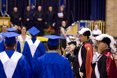 Record-Eagle/Jan-Michael Stump<br /> An honor guard from the Grand Traverse Assembly Knights of Columbus No. 00499 lines the aisles as Traverse City St. Francis High School seniors process into the gym for Sunday's graduation.