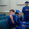 Record-Eagle/Jan-Michael Stump<br /> Traverse City St. Francis High School senior Isaac Richardson (Cq), waits with classmates before the start of graduation Sunday.