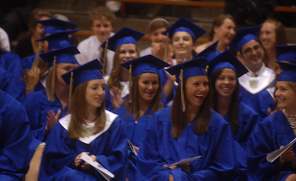 Record-Eagle/Sarah Brower<br /> St. Francis seniors laugh at Tyler Hooper's Salutatorian Address when he comments that the Saint Francis football team has won more games at Ford Field than the Detroit Lions have.