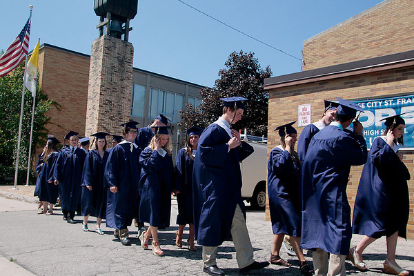 Record-Eagle/Jan-Michael Stump<br /> Traverse City St. Francis seniors line for for the procession into Sunday's graduation.