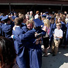 Record-Eagle/Jan-Michael Stump<br /> Traverse City St. Francis graduates share a group hug following Sunday's ceremony in th school gym.