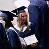 Record-Eagle/Jan-Michael Stump<br /> Elizabeth Stachnik (cq) shows off her diploma during Traverse City St. Francis' graduation Sunday.