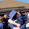 Record-Eagle/Jan-Michael Stump<br /> Harold Kranick hugs Kate DeYoung following Traverse City St. Francis' graduation Sunday.