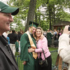 Record-Eagle/ Keith King<br /> T.J. Leitner, 17, of Traverse City, has his photo taken with his aunt, Penny Beck, of Charlevoix, as his father Jeff Leitner, of Traverse City, stands near Saturday, June 12, 2010 during the Traverse City West Senior High School graduation ceremony at Kresge Auditorium.