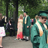 Record-Eagle/ Keith King<br /> Melissa Wilson has her picture taken with her brother, Craig Wilson, 18, of Traverse City, Saturday, June 12, 2010 as Craig waits in line with his Traverse City West Senior High School classmates prior to the beginning of their graduation ceremony. Craig has a five-year full-ride scholarship to Grand Valley State University.