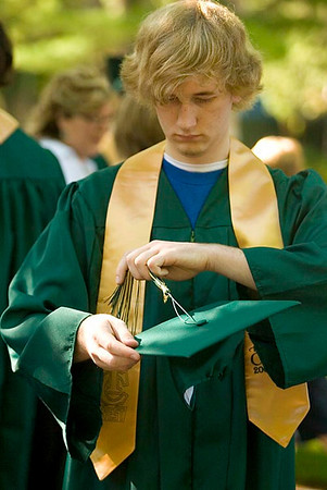Record-Eagle/Jan-Michael Stump<br /> Traverse City West High School senior Allen Rice (cq) adjusts the tassle on his mortarboard before Saturday's graduation at the Interlochen Center for the Arts.