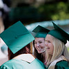 Record-Eagle/Jan-Michael Stump<br /> From left, Holly Stewart, Jennifer Payne and Mackenzie Fedorinchik laugh before the start of Traverse City West's commencement Sunday at Interlochen Center for the Arts.