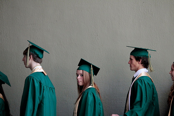Record-Eagle/Jan-Michael Stump<br /> Traverse City West seniors line p to receive their diplomas during commencement Sunday at the Interlochen Center for the Arts.