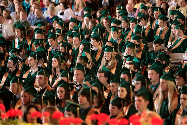 Record-Eagle/Jan-Michael Stump<br /> Traverse City West seniors listen to speakers during their commencement Sunday at the Interlochen Center for the Arts.