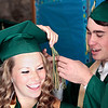 Record-Eagle/Jan-Michael Stump<br /> Megan Ankerson gets help with her tassel from Alex Aprill before the start of Traverse City West's commencement Sunday at Interlochen Center for the Arts.