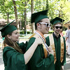 Record-Eagle/Keith King<br /> Ashleigh Hammond, left, helps adjust the stole of Pierce Thomas, middle, while Alex Courville, at right, stands near, Sunday, June 5, 2011 prior to the start of the Traverse City West High School graduation ceremony at the Interlochen Center for the Arts.